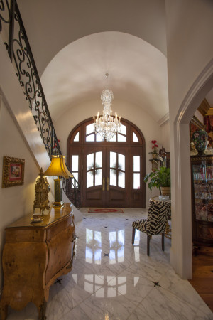 Two story foyer at custom marble-tiled entry